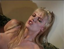 Busty blonde gets cum on her face after getting her pussy pounded on the couch