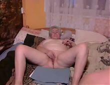 Granny Eve sucks and fucks online with a young lover without