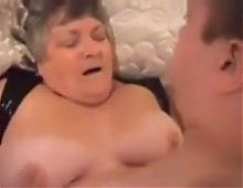 Old fat whore in sexy leather clothes gets fucked by Martin.