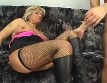 Slutty Granny in boots and stockings is an escort