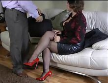 British mature beauty in leather skirt and patent red heels