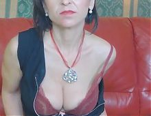Mature plays with her tits