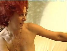 Red headed MILF gets a facial